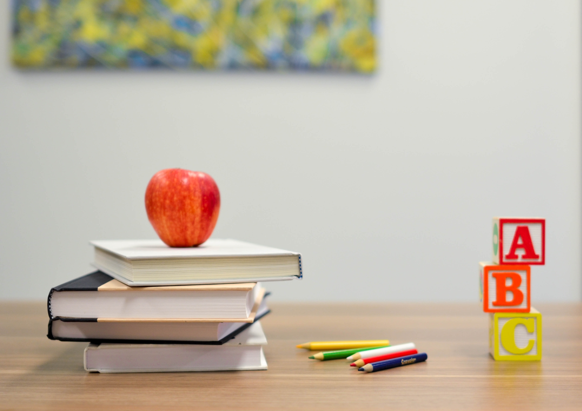 picture of school books and other things on a desk