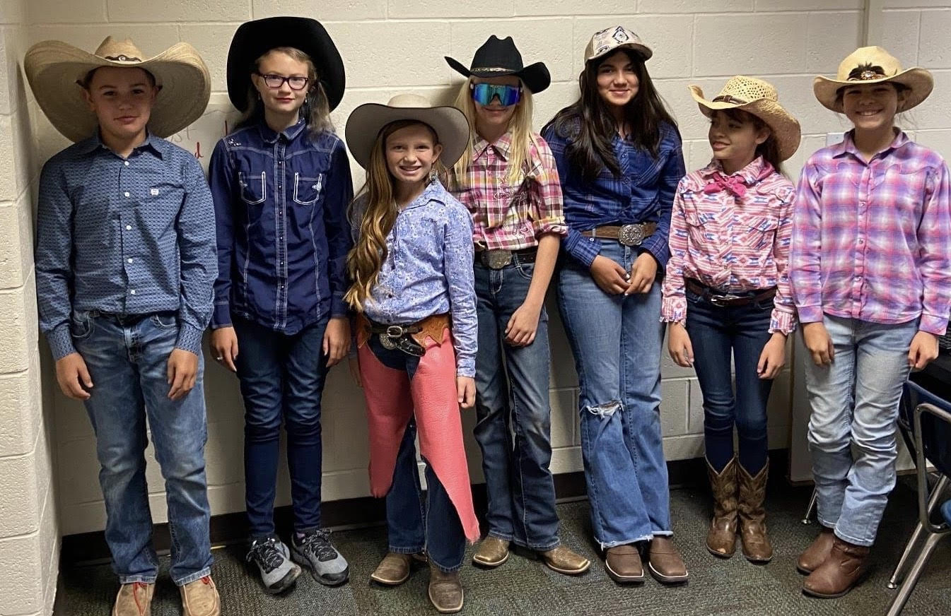 students in cowboy and cow girl outfits